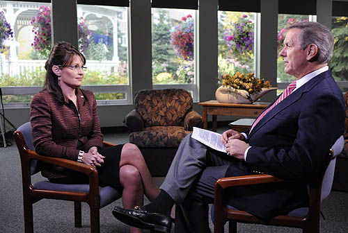 Charles Gibson tries not to look condescending as Sarah Palin looks on.