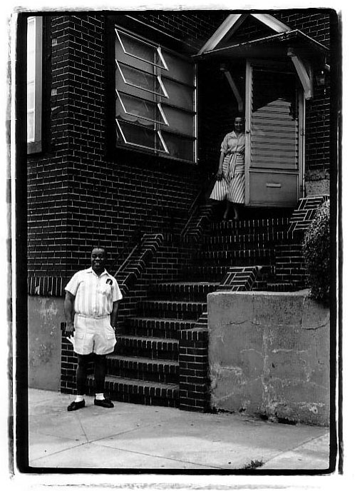 Louis Armstrong in front of his house.